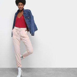 Calça Jeans Skinny Chocomenta Cintura Média Feminina. Ver similares.  Confira · Calça Drezzup Lisa Tecido Plano Feminina 91cb9c2742fe9